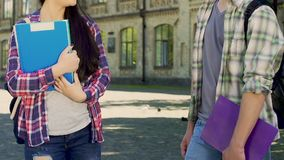 Male and female college students having conversation near university, classmates. Stock footage stock footage