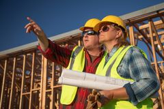 Male and Female Construction Workers at Construction Site royalty free stock photo