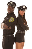 Male and female cop back to back serious Stock Photo