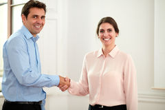 Male and female coworkers giving hands greeting Stock Photo