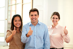 Male and female coworkers with ok sign Royalty Free Stock Images