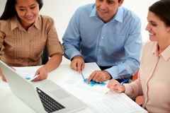 Male and female coworkers working on documents Stock Images