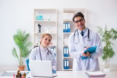 The male and female doctor having discussion in hospital. Male and female doctor having discussion in hospital Stock Photos