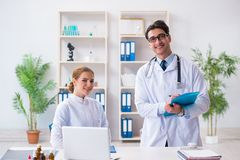 The male and female doctor having discussion in hospital. Male and female doctor having discussion in hospital Royalty Free Stock Images