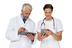 Male and female doctors with digital tablets Royalty Free Stock Photos