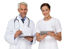 Male and female doctors with digital tablets Stock Images