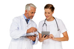 Male and female doctors with digital tablets Royalty Free Stock Photography