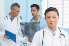 Male and female doctors examining x-ray Stock Image