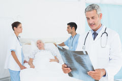 Male and female doctors examining x-ray Royalty Free Stock Photo