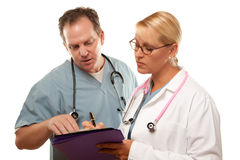Male and Female Doctors Looking Over Files Stock Photo