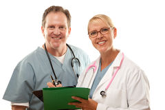 Male and Female Doctors Looking Over Files Stock Photos