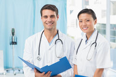 Male and female doctors Stock Photos
