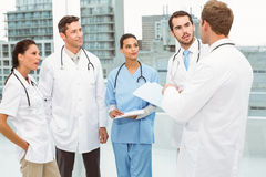 Male and female doctors in meeting Stock Photography