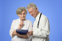 Male and female doctors. Portrait of a male and female doctors discussing diagnosis Royalty Free Stock Images