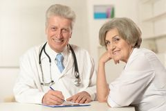 Male and female doctors. Portrait of male and female doctors working Royalty Free Stock Photo