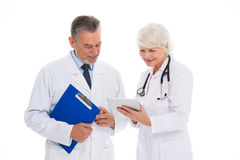 Male and female doctors. Portrait of male and female doctors standing over white background Stock Image