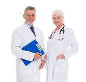 Male and female doctors. Portrait of male and female doctors standing over white background Royalty Free Stock Photography