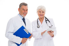 Male and female doctors. Portrait of male and female doctors standing over white background Stock Photo