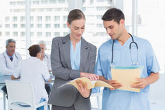 Male and female doctors with reports. In the hospitals Royalty Free Stock Photo