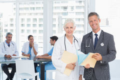 Male and female doctors with reports Stock Photography