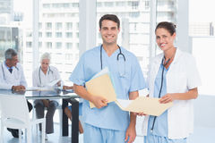 Male and female doctors with reports Royalty Free Stock Photography