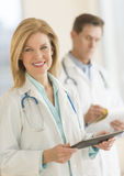 Male And Female Doctors Using Digital Tablet In Hospital Stock Photos