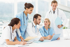 Male and female doctors using digital tablet Royalty Free Stock Image