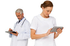 Male and female doctors using digital tablets Stock Photography