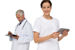 Male and female doctors using digital tablets Royalty Free Stock Photos
