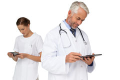 Male and female doctors using digital tablets Royalty Free Stock Photography