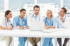 Male and female doctors using laptop Stock Photos