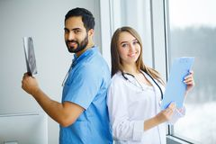 Male and female doctors work together in hospital.  Stock Photo