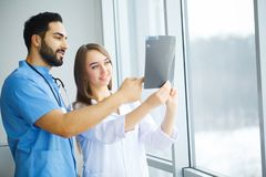Male and female doctors work together in hospital.  Stock Photography