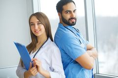 Male and female doctors work together in hospital.  Royalty Free Stock Photos