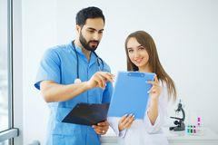 Male and female doctors work together in hospital.  Royalty Free Stock Photography