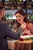 Male and female eating in restaurant Stock Photos
