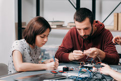 Male and female engineers constructing diy model Stock Images