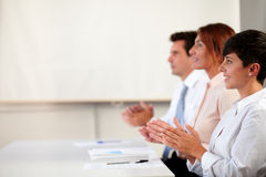 Male and female executive giving applause Stock Images