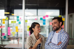 Male and female executive interacting with each other Royalty Free Stock Images
