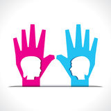 Male and female face on palm Royalty Free Stock Image
