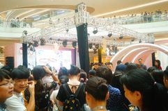 Shenzhen, China: male and female fans are waiting to watch Hongkong actress Myolie Wu D. Male and female fans wait to watch Hong Kong star hu xinger arrive at Stock Photography