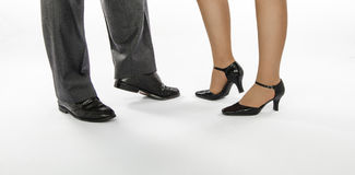 Male and female feet of dance couple. Male and female feet in crocodile leather shoes are ready to dance Royalty Free Stock Photos
