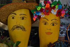 Male and female figures are made of pumpkins. Yellow pumpkin with a hat and a wreath royalty free stock photo