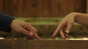 Male and female fingers walk towards each other, love sign. Stock footage stock video footage