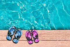 Male and female flip flops and swimming poo Stock Photo
