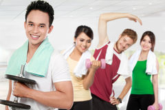 Male and female friends doing exercise Royalty Free Stock Images