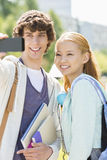 Male and female friends taking selfie with smart phone at college campus Royalty Free Stock Image