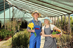 Male and female gardeners in a garden Stock Photo