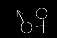 Male and female gender symbols, mars and venus. Royalty Free Stock Photo