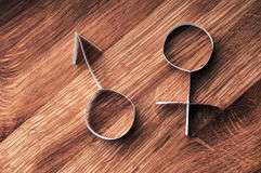 Male and female gender symbols, mars and venus. Male and female gender symbols, mars and venus on wooden background stock photos